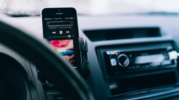 You can play music from phone to car by using the in-built USB port