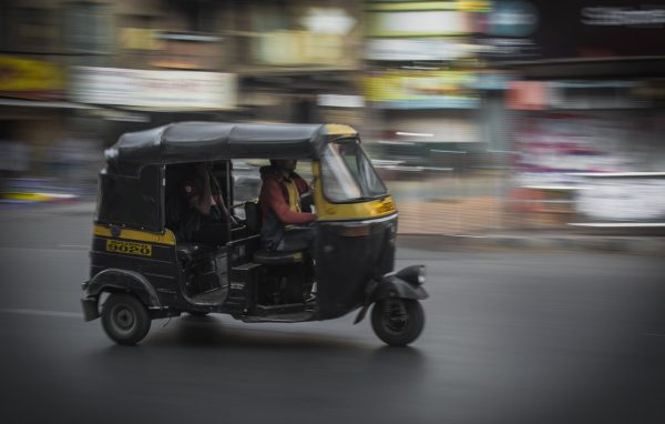 action photo of auto rickshaw shot using camera panning technique