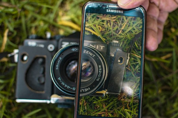 DSLR camera and smartphone in one photo