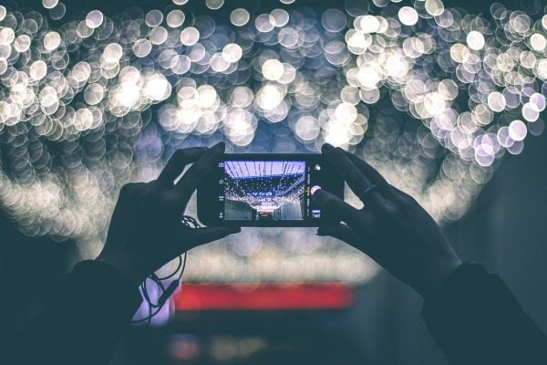 taking a photo of lights at night with a smartphone