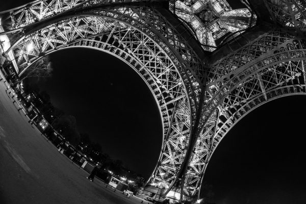 photo of the Eiffel tower underside taken with a fisheye lens