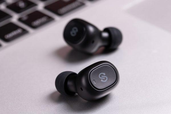 wireless earbuds on a laptop