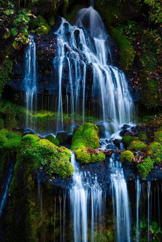 A cool and beautiful wallpaper of a serene waterfall for your mobile screen.