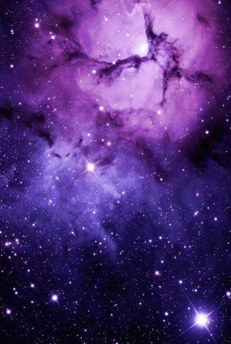A mesmerizing wallpaper of the galaxy shining in purple.