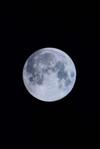 A classic wallpaper of a blue moon in a black background.