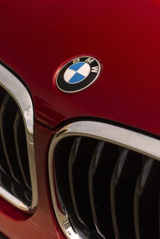 Download Red Bmw Car With Logo Wallpaper Cellularnews