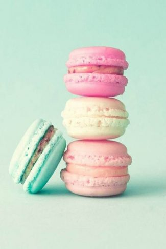 Light and fluffy French macarons in pastel colors.