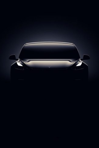 Download Dark Tesla Car In The Shadows Wallpaper Cellularnews