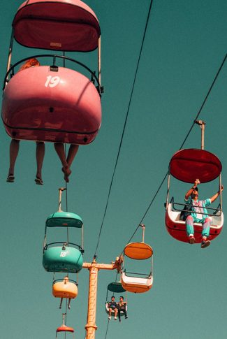 Nice and cute, vintage carnival cable car in pastel colors.