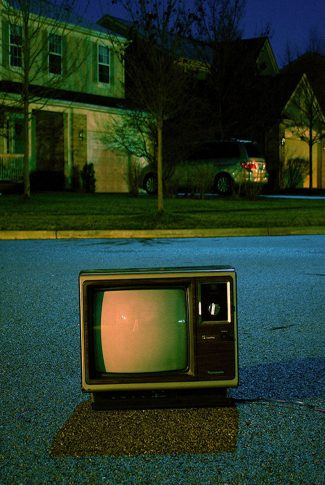 Nice and clear shot of a vintage television on the streets.