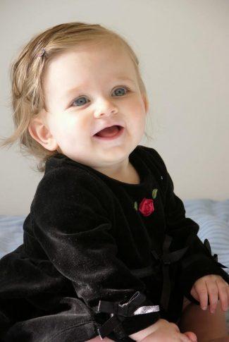 Download Baby Girl In Black Dress Wallpaper Cellularnews