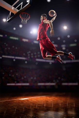 Basket baller doing the perfect slam dunk wallpaper