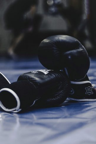 Nice and smooth, pair of black boxing gloves in the ring.