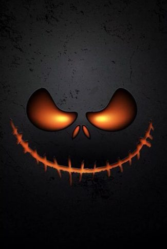 A creepy pumpkin face smiling at your in halloween.