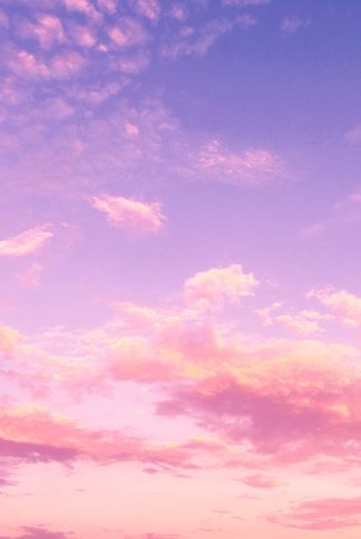 A purple and pink sunset with clouds on sky.