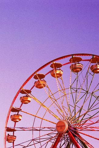 A sunset dream below a ferris wheel. You feel sad and empty. But you have no choice to wake up in a cruel world.