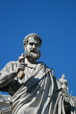 Nice and neat, simple sculpture of a male saint on a sunny day.