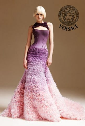 Tall and beautiful model in a stylish Versace dress of purple and pink.