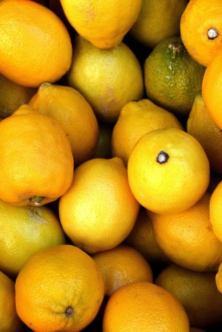 A fresh and yellow lemons in one image. This is pure of vitamin C.