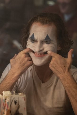 Download The Joker S Smile Wallpaper Cellularnews