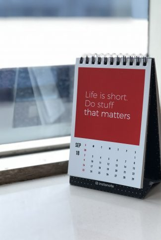 Every one in this world is on a borrowed time. Seize the day! A motivational quote wallpaper on a calendar.