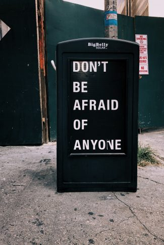 There is no reason to be afraid of anyone or anything else for any matter. You make your own fears. Make none. A motivational quote wallpaper on a news/letter stand.
