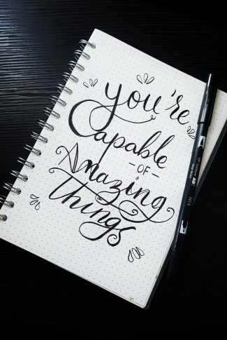 Do not sell yourself short. You can do amazing things just as you are amazing yourself. A motivational quote wallpaper written on a notebook in calligraphy.