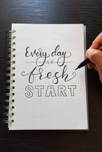 You may feel like you did terrible today but you can always definitely turn it around the next day. A motivational quote wallpaper written on a notebook in calligraphy.