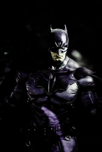 Batman is giving his fierce look to you.