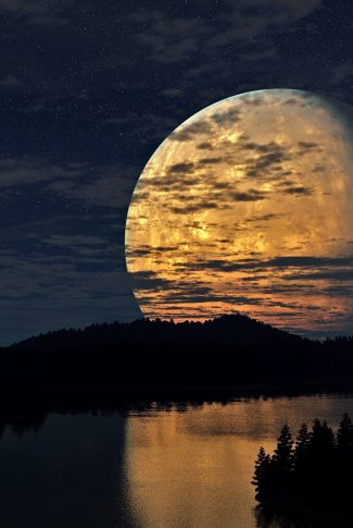 A mesmerizing wallpaper of a huge planet in the cloudy sky by the lake at night.