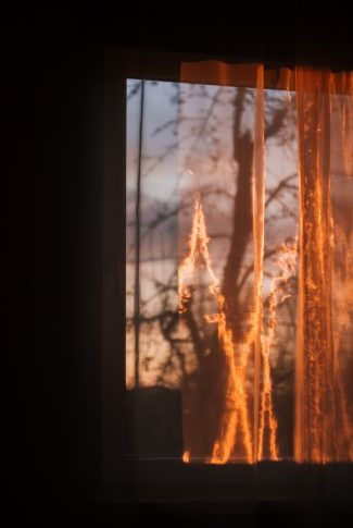 A cool wallpaper of a holographic fire on a window curtain.