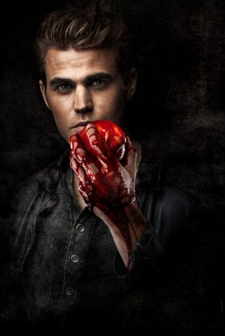 An eerie The Vampire Diaries character poster of Stefan Salvatore holding a blood-covered fruit.