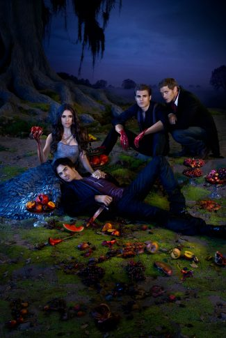 A cool The Vampire Diaries Season 3 promotional poster with Damon Salvatore, Stefan Salvatore, Niklaus Mikaelson and Elena Gilbert surrounded by bloody fruits.